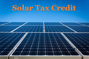 Graphic showing solar panels with the text 'Solar Tax Credit'